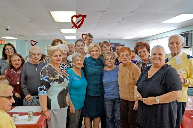 Congresswoman Carolyn Maloney (center) with Swinging Sixties Seniors; Mary Ciorciari, St. Nicks Alliance Director of Homecare (far left); and Frank Lang, St. Nicks Alliance Director of Housing