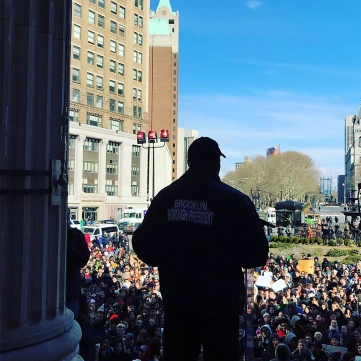 Brooklyn Borough President cheers on the student ralliers for safer gun laws at Borough Hall during the National School Walkout on March 14